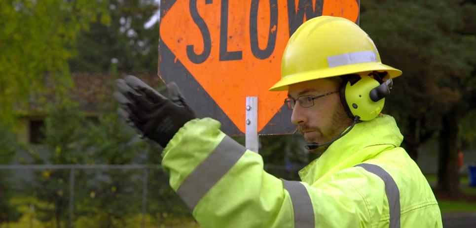 Public works traffic controller wearing Apex Team Wireless Headset.
